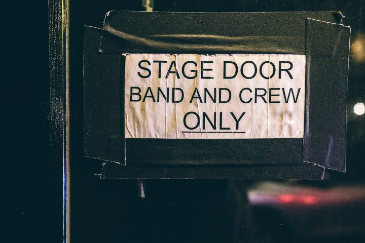 Image of stage door with sign